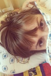 Lena Dunham takes a bed selfie