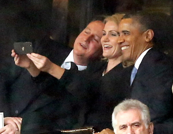 president selfie during the requiem for Nelson Mandela