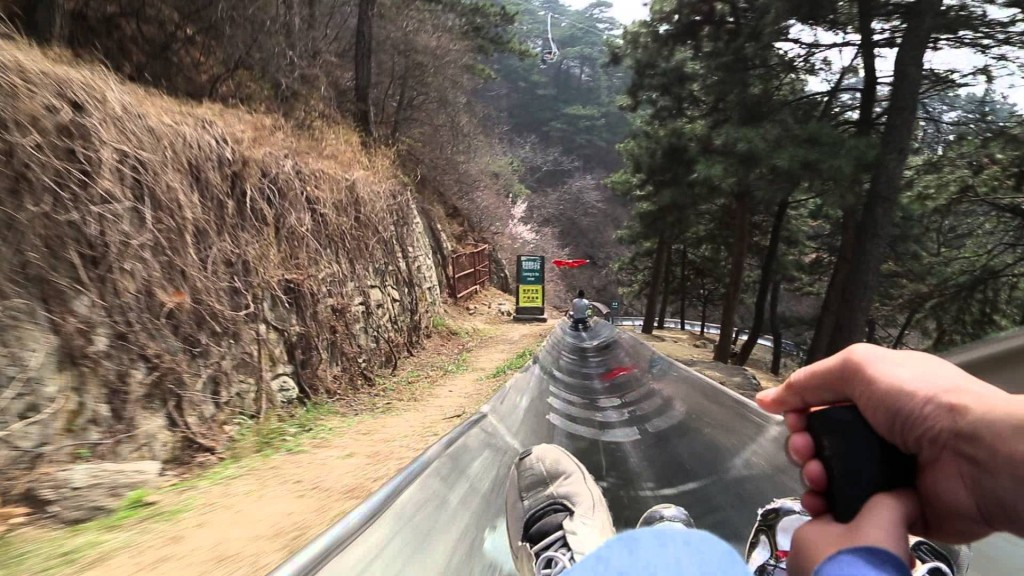 toboggan down from the Great Wall of China