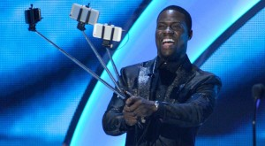 Kevin Hart with selfie sticks