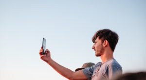 a man taking a selfie, blue sky, light, johan mouchet