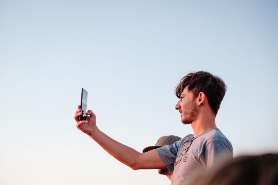 a man taking a selfie, blue sky, light, johan mouchet