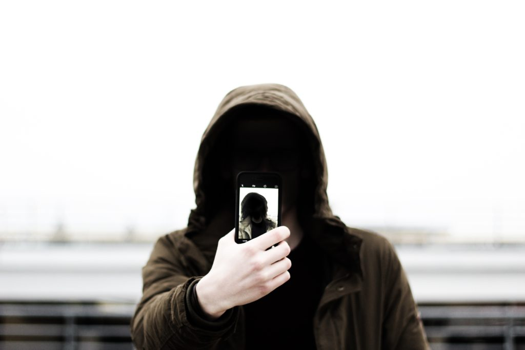 an invisible man taking a selfie, tom sodoge